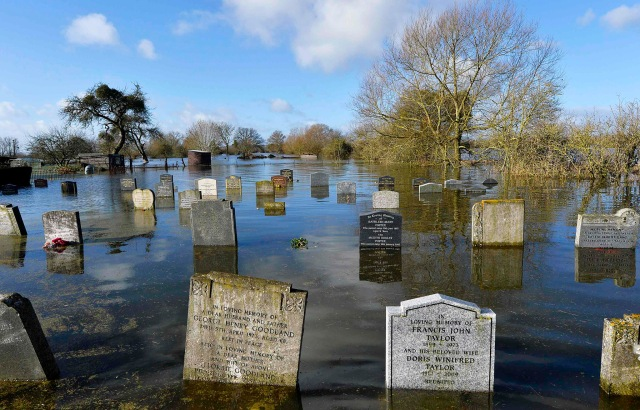 A graveyard is seen underwater in the village of Moorland in south west England